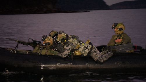 They keep a low profile against a possible enemy radar. From that position the divers can simply roll into the water. (9NEWS)