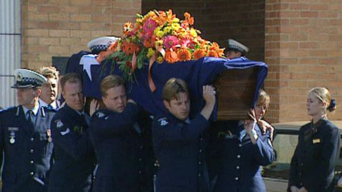 Colleagues carry Constable Rodney Miller's coffin at the funeral service in 1998.