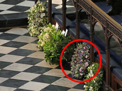 Meghan and Harry's wreath for the Duke of Edinburgh's funeral. Wreaths from members of the royal family lie against the pews during the funeral of Prince Philip, Duke of Edinburgh at Windsor Castle on April 17, 2021 in Windsor, United Kingdom