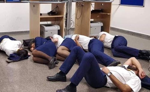 Six Ryanair staff members were sacked over this allegedly staged photograph of them sleeping on an airport floor.
