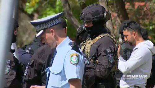 Heavily armed tactical officers swooped on the men in the Audi. (9NEWS)