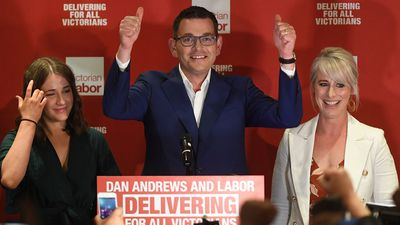 Daniel Andrews, alongside his wife Cath, delivers a victory speech to a raucous crowd.