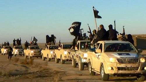 IS militants near the Syrian city of Raqqa. (AAP)