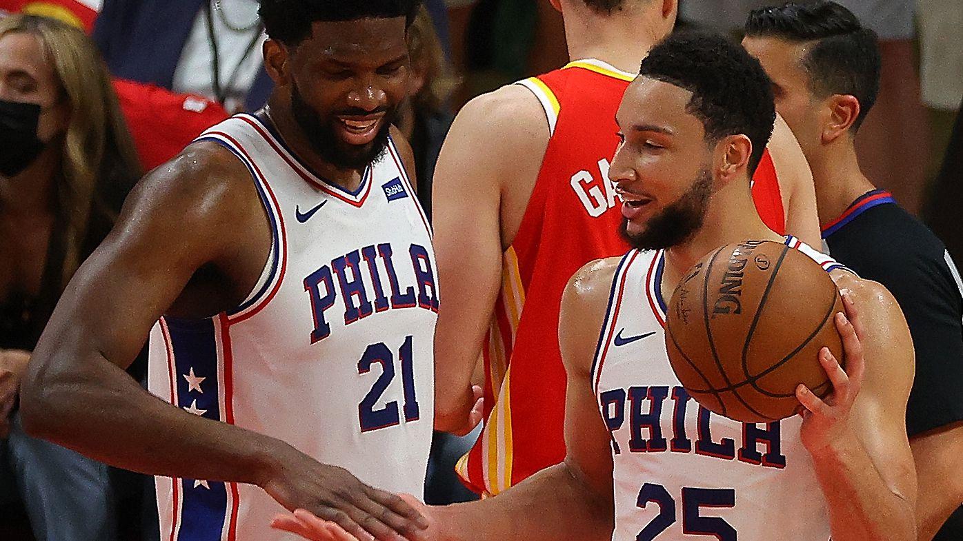Ben Simmons #25 and Joel Embiid #21 of the Philadelphia 76ers