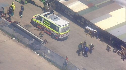 Two men have suffered electric shocks on a Sydney roof, with one man still stuck on top of the factory.