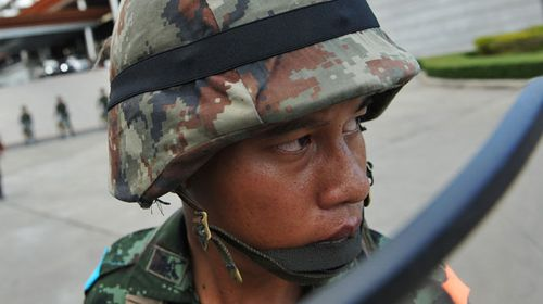 A Thai army soldier stands on guard. (Getty)