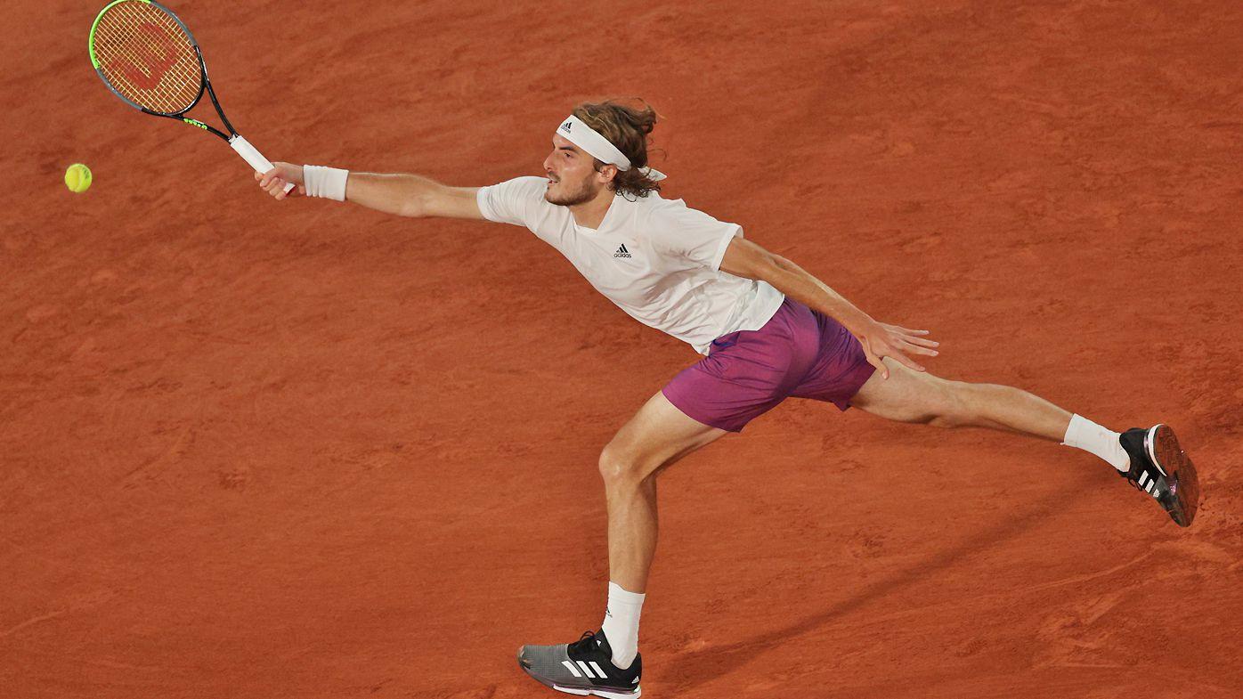 Stefanos Tsitsipas defeats American John Isner at Roland Garros