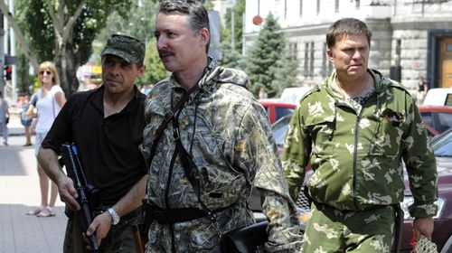 Commander and self-proclaimed minister of Defence of so the called 'Donetsk People's Republic' Igor Girkin, aka Strelok, walks with his bodyguards in the eastern Ukrainian city of Donetsk on July 11, 2014. (Getty)