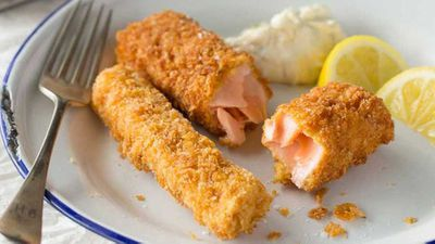 Crunchy baked salmon fish fingers with tartare sauce and sweet potato chips