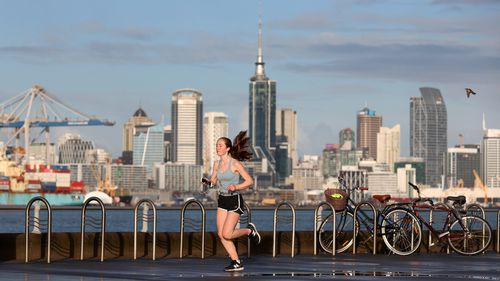 A lone runner along Devonport's waterfront as Auckland wakes to level four lockdown.