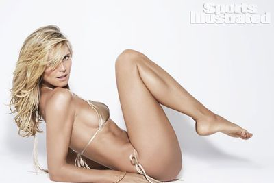 Just a few months after her 40th birthday, Heidi (now 41) posed for <i>Sports Illustrated</i>'s 50th anniversary.