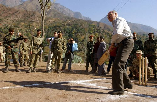 In 2005, the Pakistani Army asked if Mr Howard, a cricket tragic, would bowl to a group of children.