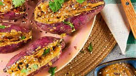 Microwave sweet potatoes with miso tahini butter