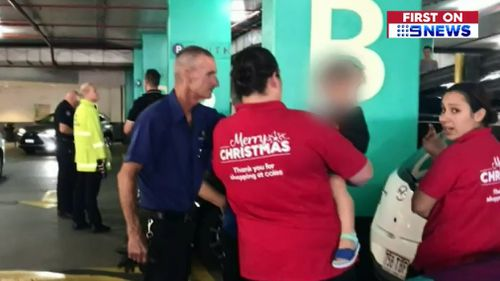 Shop staff comforted the toddler after he was freed. (9NEWS)
