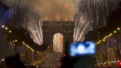 France celebrates as thousands pack the Champs Elysees. (AAP)