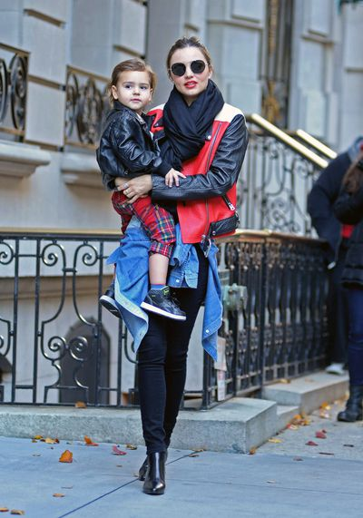 Miranda Kerr's skinny jeans and bomber jacket combo is a fail safe stylish mum go-to. She's with son Flynn in New York this year.