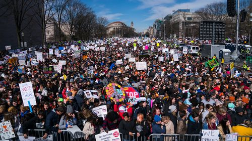Thousands of people crowd Constitution Avenue for the March For Our Lives in Washington, DC, USA. (EPA/AAP)