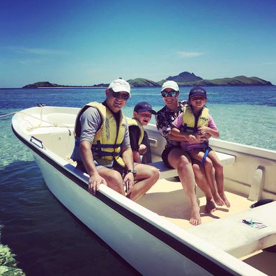 Karyn Sutton with her family in a boat in Fiji