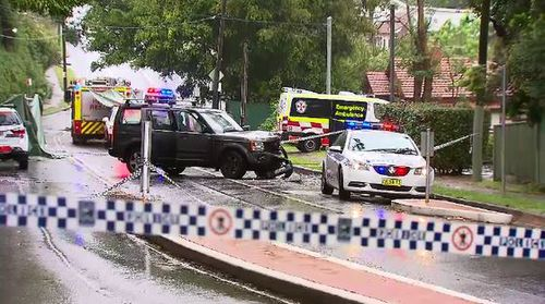 The crash closed The Esplanade as emergency services worked to clear the wreckage amid Wednesday's torrential rain.