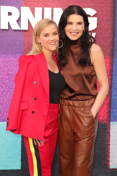 Reese Witherspoon and Julianna Margulies attend Apple TV+'s The Morning Show Photo Call at Four Seasons Hotel Los Angeles at Beverly Hills on September 08, 2021 in Los Angeles, California.