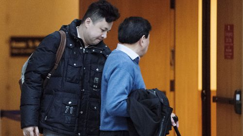 Liu Xiaozong, left, husband of Meng Wanzhou, Huawei's chief financial officer arrives at courthouse for a bail hearing for his wife in Vancouver.