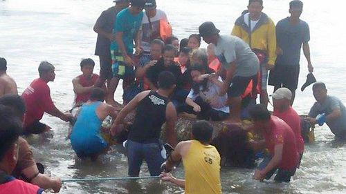 Five were killed after a ferry carrying more than 250 passengers sank in the Philippines.