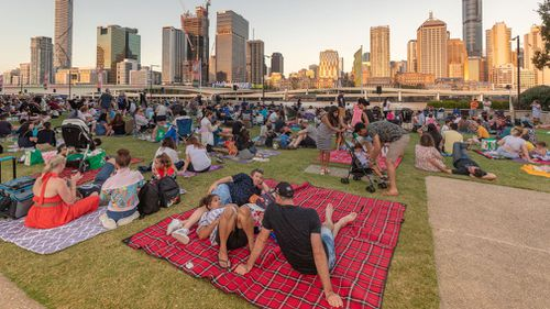 Crowds gather to watch the fireworks show in Brisbane.
