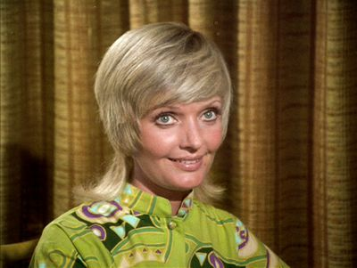 Carol Brady, played by Florence Henderson in <em>The Brady Bunch</em>, started out as a stitched up sixties housewife but very quickly got groovy with this shag/mullet at its peak in 1972. Far cooler than anything Marcia could imagine.&nbsp;