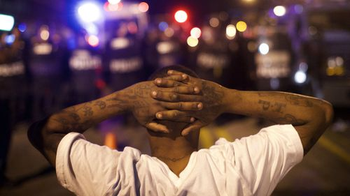 Protesters have defied a 10pm curfew to remain on Baltimore's streets. (AFP)