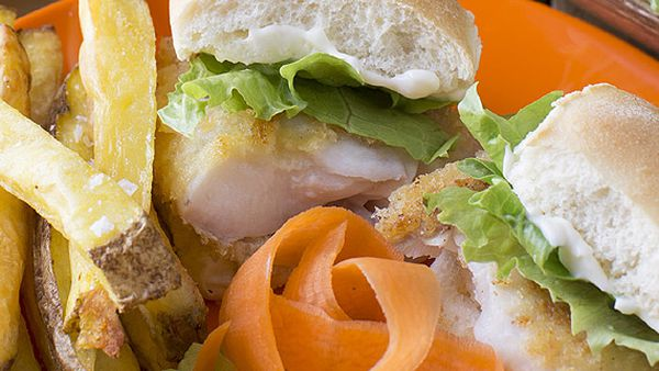Yummy barramundi burgers with oven fries, salad and mayo