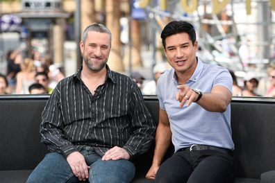 """Dustin Diamond (L) and Mario Lopez visit """"Extra"""" at Universal Studios Hollywood on May 16, 2016 in Universal City, California."""
