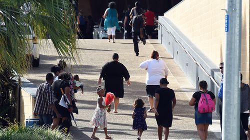 Mourners arrive at the Cairns Convention Centre for the memorial service for eight children. (AAP)