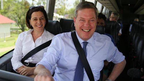 LNP leader Tim Nicholls (right) and deputy leader Deb Frecklington on the campaign bus. (AAP)