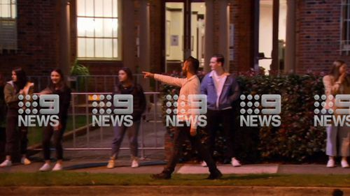 Dozens of people were seen queueing to get in to Greengate Hotel in Killara on the city's north shore last night, social distancing only when security guards spotted 9News cameras.