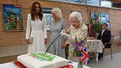Never one to do things by halves, Queen Elizabeth II showed off her sword skills Friday cutting a cake at a lunch organized by educational charity Eden Project.The Queen smiled and joked with Catherine, Duchess of Cambridge and Camilla, Duchess of Cornwall as she swapped a knife for the longer blade to slice through a cake while visiting the organizers of the Big Lunch during the G7 summit in Cornwall.