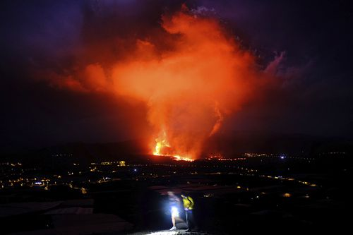 Lava spews from a volcano on the Canary island of La Palma, Spain
