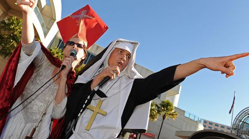 "Norrie, left, and 'Bubbleboy' sing about the Vatican's attitude to gay marriage outside the ruling Labor Party's conference during a mass ""illegal wedding"" in Sydney 2009. (Getty)"