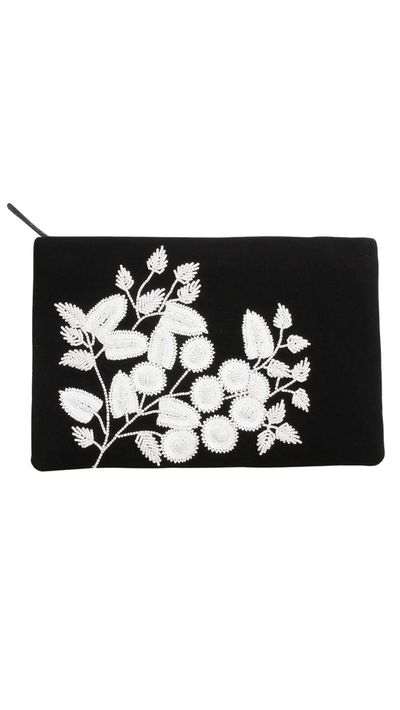 """<a href=""""http://meganpark.com.au/collections/accessories/products/15a258w_black-ivory"""" target=""""_blank"""">Audrey Evening Clutch, $249, Megan Park</a>"""
