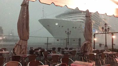 A close call for the Costa Deliziosa, as the liner loses control during a storm and nearly collides with a Venice dock.