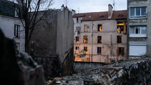 The back of a building raided by police in Saint-Denis. (AAP)