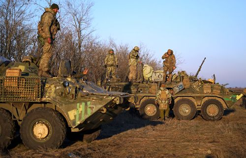Ukrainian soldiers take a position near Urzuf, south coast of Azov sea, eastern Ukraine.