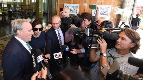 Cranston addresses the media after being found not guilty of misusing his position within the Tax Office.