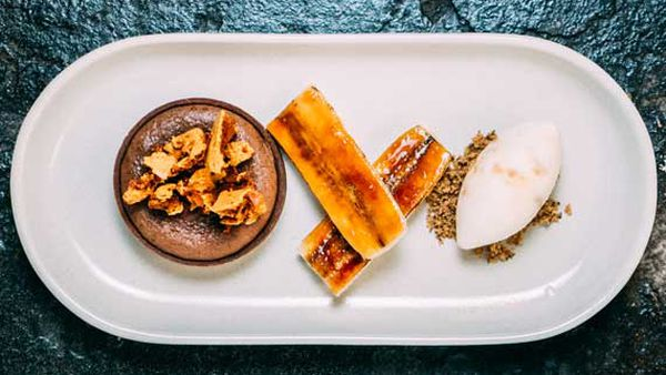 Gooey chocolate tart with caramelised banana, honeycomb and ice-cream