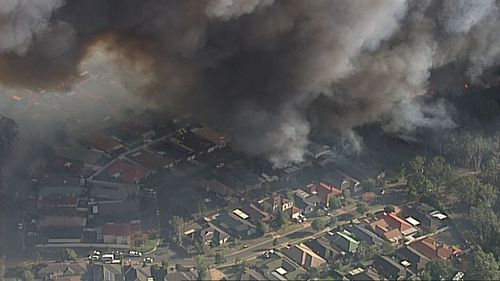 "The ""fast-moving"" fire moved towards homes at Holsworthy and Wattle Grove. (9NEWS)"
