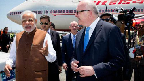 Indian Prime Minister Narendra Modi is greeted by Attorney-General George Brandis on the tarmac in Brisbane. (AAP)