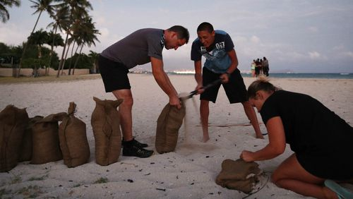 Residents prepare sandbags for the approaching storm