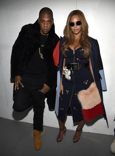 Jay-Z and Beyonce in a cropped top and pencil skirt by luxury designer Charles Harbison at the Adidas Originals x Kanye West Yeezy Season 1 Show in New York City 2015
