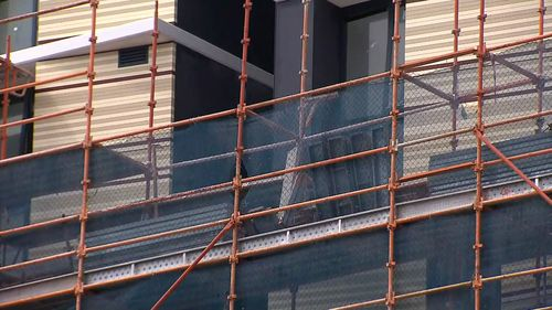 Workers are believed to have been injured by scaffolding surrounding the site.