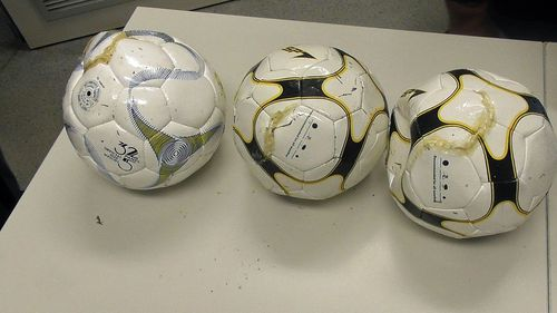 A photo of the three soccer balls seized at a NSW prison.