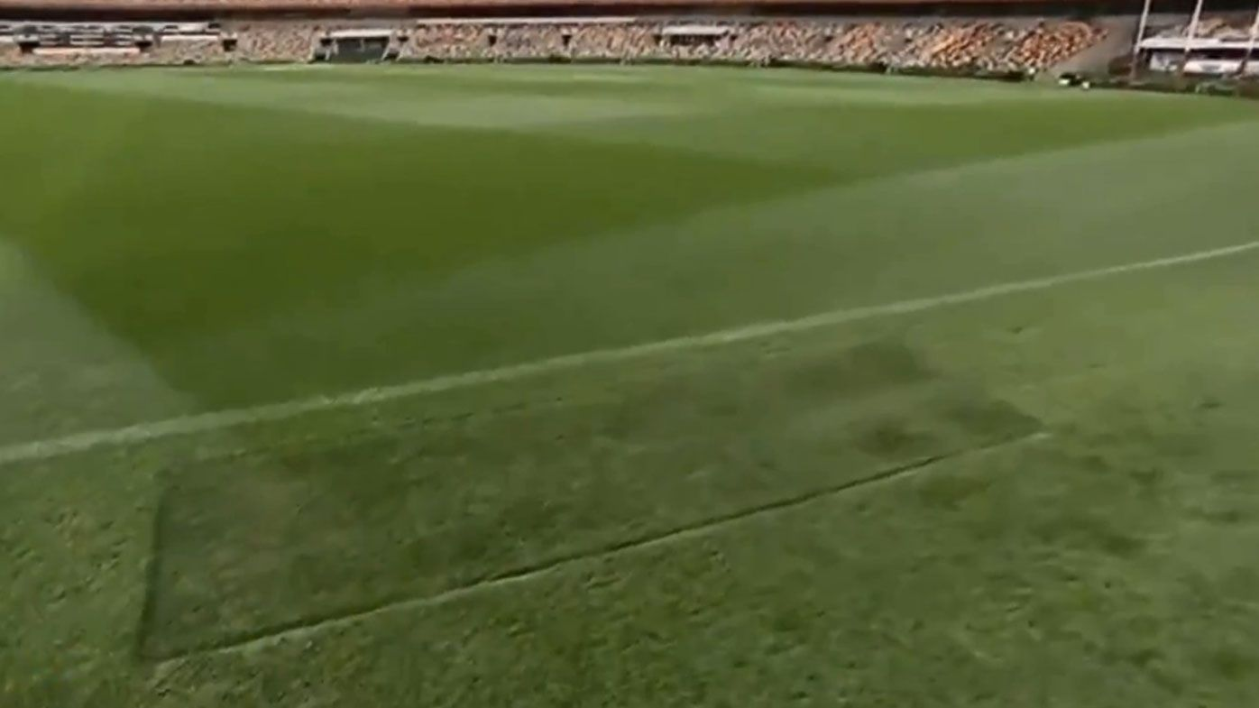The patch of MCG goalsquare turf finds its new home at the Gabba.